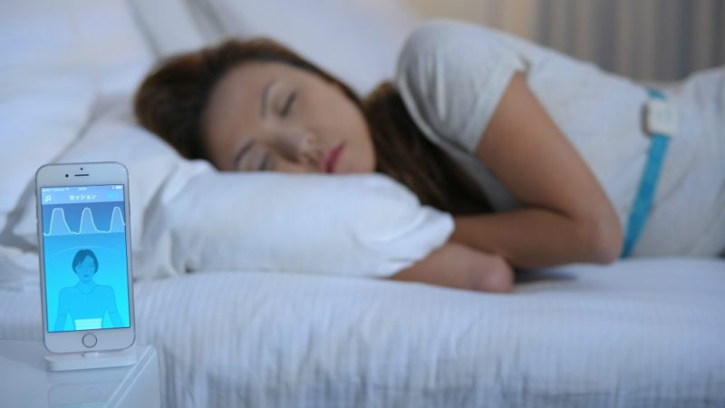 women sleeping on bed wearing white dress